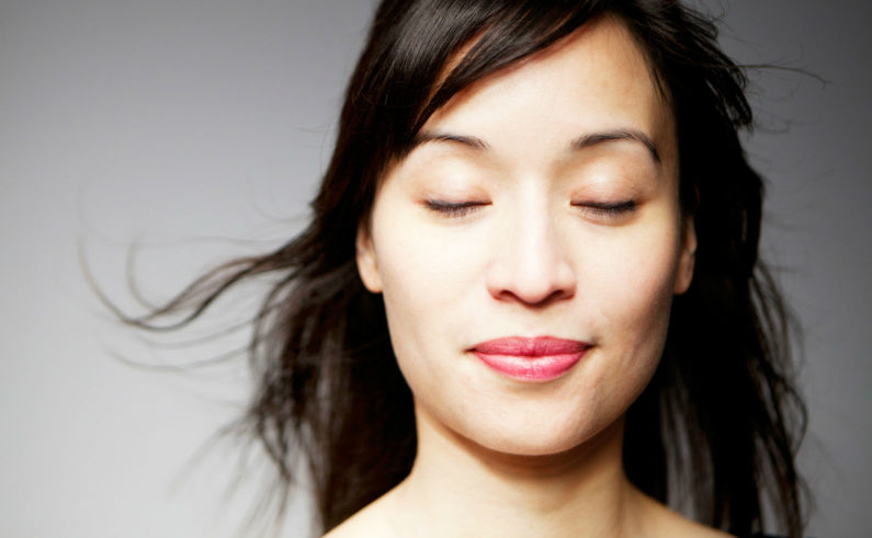 Mixed-Race-Woman-with-Eyes-Closed-and-Smiling-final